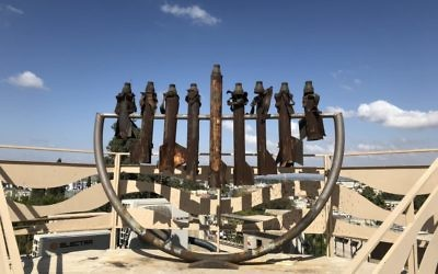 The menorah made of rockets on top of the Hesder Yeshivah.