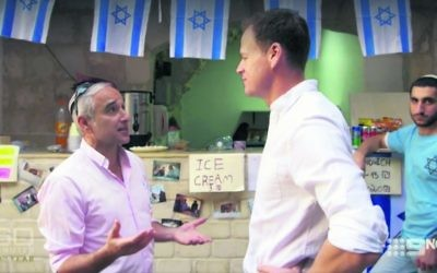 Daniel Luria (left) talking to Tom Steinfort at a shop he has set up in the Muslim Quarter of the Old City.  Photo: Screengrab