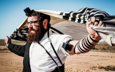 Rabbi Yossi Rodal prays in central Australia during a trip by Chabad of RARA which was filmed for a SBS documentary.
