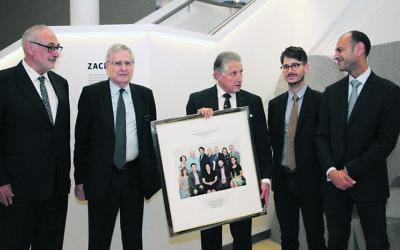 From left: Gus Lehrer, Norman Selingman and Robert Schneider from the SJM presenting a framed photograph to relatives of Isaac and Susan Wakil, Adam Lippmann and David Khedoori. Photo: Shane Desiatnik