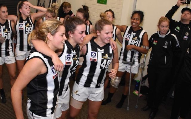 Ally Bild (right, no.48) in the winners' circle after her first VFLW game for Collingwood.Photo: Luke Henry - LH Photography