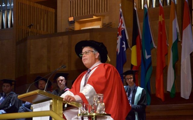 HP president and CEO Dion Weisler accepts his honorary Doctorate of Laws at Monash University.