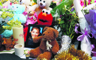 A photo of Thalia amid the floral tributes at the site of the Bourke Street tragedy last year. Photo: Peter Haskin