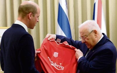 Prince WIlliam presenting Reuven Rivlin with a Liverpool FC shirt. Photo: Mark Neiman/GPO