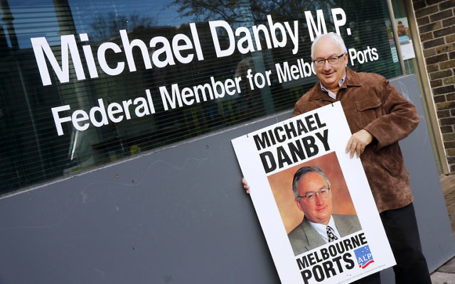 Michael Danby, holding a poster from his first election campaign in 1998, at his Fitzroy Street office in St Kilda after announcing he will not be standing for re-election at the next federal election.      Photo: Peter Haskin