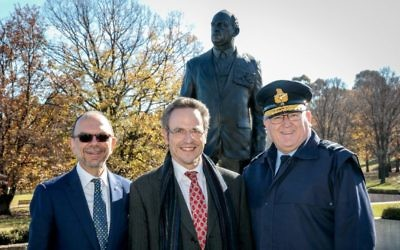 From left, Rabbi Ralph Genende, Michael Bennett, Monash's great-grandson, and Air Commodore Mark Willis in front of the sculpture. Photo: David Whittaker