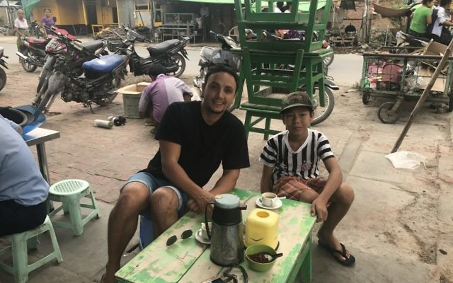 Richie Harkham with Tai, an 11-year-old boy he met in Myanmar.