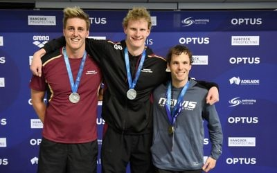 Matthew Levy (right) with his gold medal for winning the men's multi-class 400 free final. Photo: Delly Carr/Swimming Australia Ltd