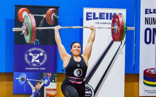 Leora Yates raises the bar at the 2018 Victorian Weightlifting Championships in early July. She will go to Barcelona next month to compete at the 2018 IWF Masters Weightlifting World Championships. Photo: Black Rose Australia