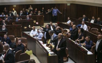 Arab lawmakers protest as the Knesset debates the nation-state bill.  Photo: AP Photo/Olivier Fitoussi