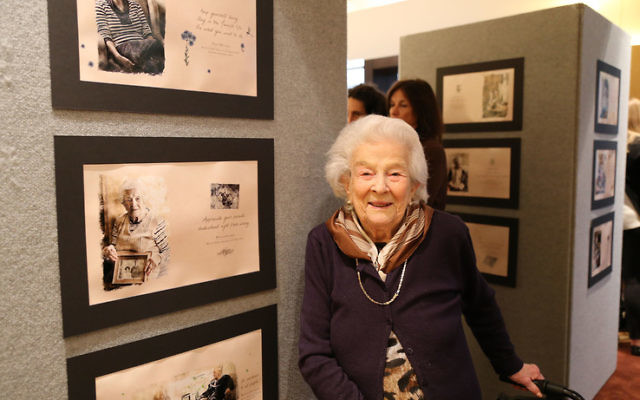 Phyllis Glasser with her page from the book. Photo: Nadine Saacks Photography.
