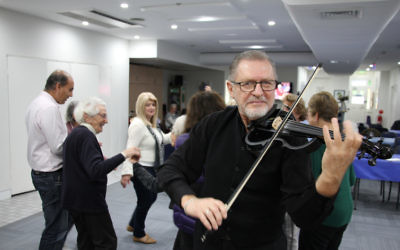 Nik Djumin playing klezmer tunes for COA Sydney clients and staff.  Photo: Shane Desiatnik