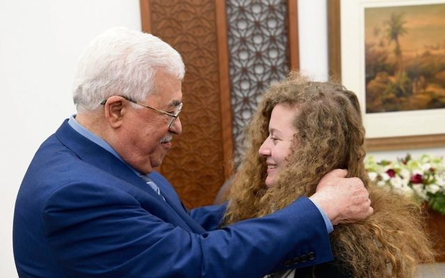 Mahmoud Abbas welcoming Ahed Tamimi after her release from an Israeli prison. Photo: EPA/Thaer Ghanaim
