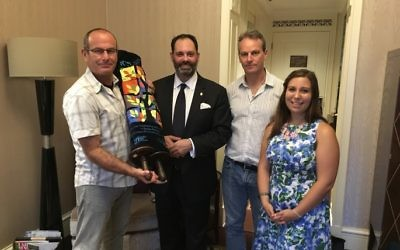 With the rejuvenated Sefer Torah, from left, Dvir Bar-Gal, Philip Dalidakis, Drew Nuland and Kehilat Shanghai's community coordinator Hannah Maia Frishberg.