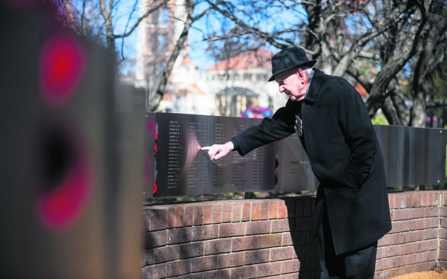Jules Hoffman points to his brother Adolf's name on the National Jewish War Memorial. Photo: Dion Georgopoulos