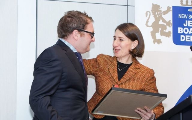 Premier Gladys Berejiklian presented Jeremy Spinak with a special commendation at the JBOD AGM in August. Photo: Giselle Haber