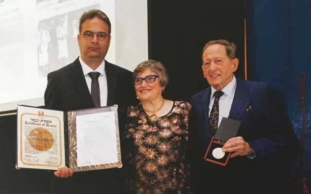 From left: Rejhan Prohic, Aviva Fox and Egon Sonnenschein with the Righteous accolade bestowed by Yad Vashem.
