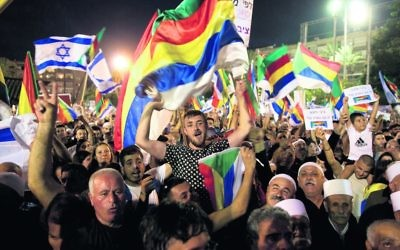 Thousands joined the Druze protest against the new law on Saturday night in Tel Aviv. Photo: AP Photo/Sebastian Scheiner