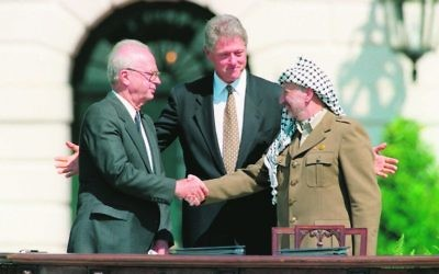 President Bill Clinton (centre), presiding over ceremonies marking the signing of the 1993 peace accord between Israeli Prime Minister Yitzhak Rabin (left) and PLO chairman Yasser Arafat on September 13, 1993. Photo: AP Photo/Ron Edmonds
