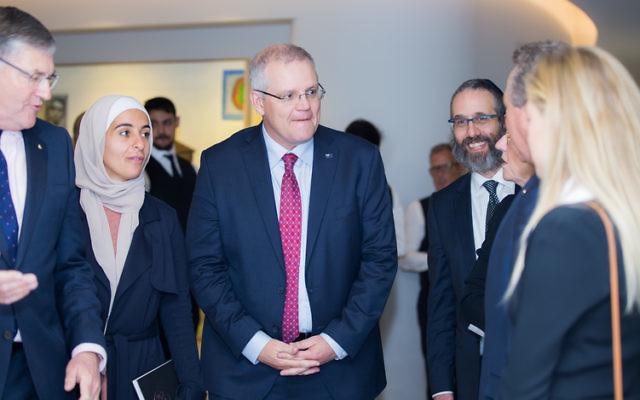 Prime Minister Scott Morrison (centre) with Amna Karra Hassan (left) and Rabbi Zalman Kastel (right).