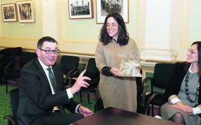 Rebbetzin Dina Kahn presents Premier Daniel Andrews with a gift on behalf of the RCV.  Photo: Peter Haskin