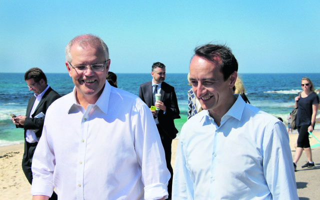 Scott Morrison (left) and Dave Sharma at Bronte Beach. Photo: Gareth Narunsky