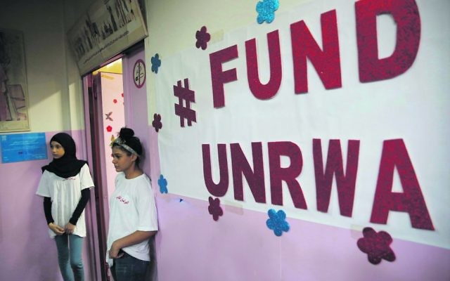 Palestinian students stand outside a classroom at a UNRWA school in Beirut. Photo: AP Photo/Hussein Malla