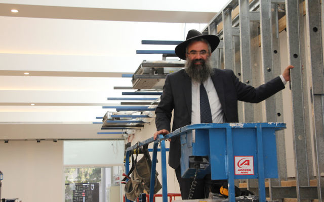 Rabbi Dovid Slavin inspecting the reconstruction of the synagogue at the Harry Triguboff Centre at Flood Street, which will reopen in time for Rosh Hashanah. Photo: Shane Desiatnik