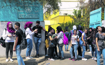 Palestinian students outside a UNRWA school in Beirut. Photo: EPA/Nabil Mounzer