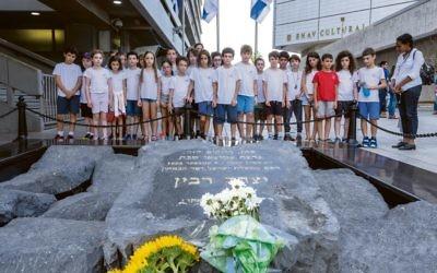 Israeli school children visit the Yitzhak Rabin memorial in Rabin Square in Tel Aviv to mark the 23rd anniversary of his assassination. Photo: EPA/Jim Hollander