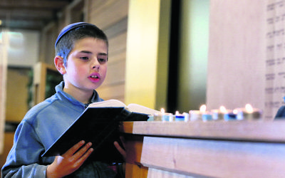 Tuvia Kastel reciting tehilim at Chabad North Shore. Photo: Noel Kessel