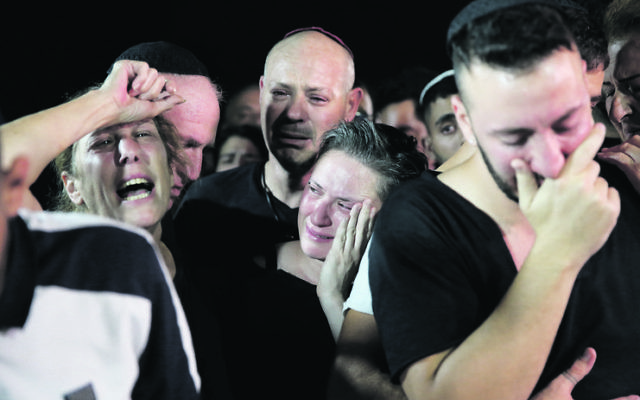 Family members at the funeral of Kim Levengrond-Yehezkel. Photo: AP Photo/Ariel Schalit
