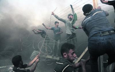 Palestinian demonstrators at the Israel–Gaza border last Friday. Photo: by Majdi Fathi/NurPhoto/Sipa USA