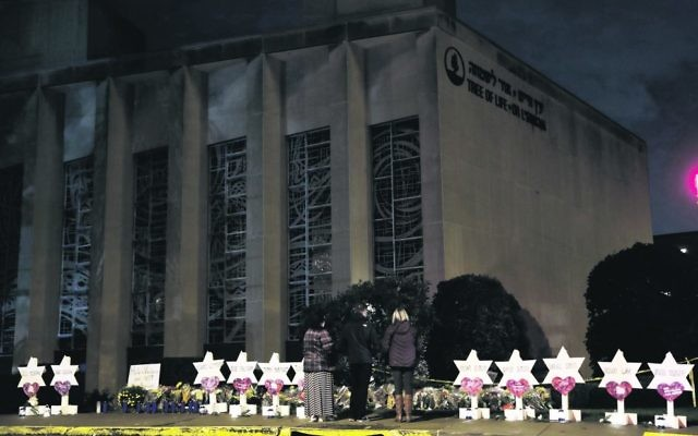 Stars of David with the names of those killed stand in front of the Tree of Life Synagogue. Photo: AP Photo/Matt Rourke