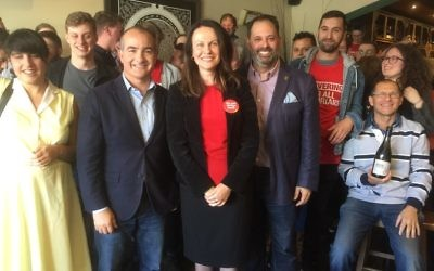 Surrounded by supporters at the launch, from left, Deputy Premier James Merlino, Caulfield candidate Sorina Grasso and Labor frontbencher Philip Dalidakis. Photo: Peter Kohn