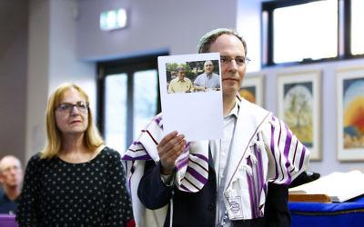 Rabbi Yonatan Sadoff holds up a photo of Cecil and David Rosenthal. Photo: Peter Haskin