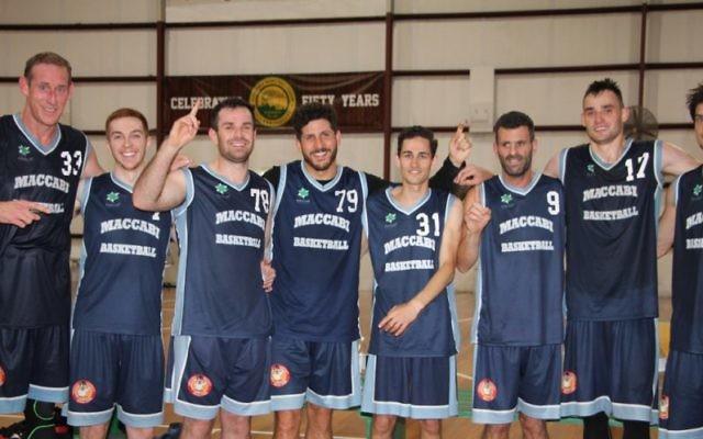 Time to celebrate: Maccabi Lakers players (from left) Ben Knight, Zach Ehrenfeld, Keyan Kramer, Josh Cohen, Marcel Ninio, Greg Shapiro, Anatoly Bose and Indiana Faithfull. Photo: Shane Desiatnik