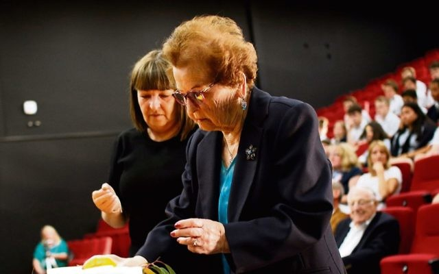 Survivor Edith Gluck lights a memorial candle with her daughter Donna at   Secondary College's Holocaust Remembrance Service. Photo: Peter Haskin