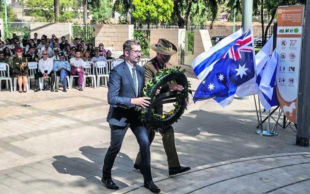 Australian ambassador to Israel Chris Cannan laying a wreath at the Beersheba commemoration.