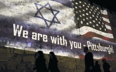 A projection on the walls of the Old City in Jerusalem. Photo: AP Photo/Dusan Vranic