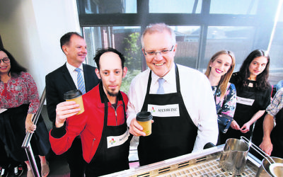 Josh Ferenbach serving Scott Morrison coffee. Photo: Peter Haskin