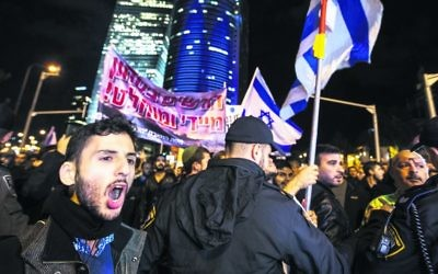 Protesters in Tel Aviv demonstrating against the government. Photo: EPA/Jim Hollander