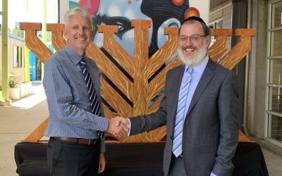 Outgoing Moriah College principal John Hamey (left) and incoming principal Rabbi Yehoshua Smukler.