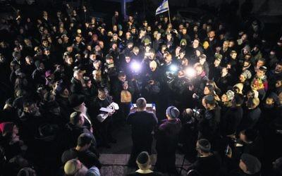 Mourners at the funeral of Amiad, the baby of Amichai and Shira Ish-Ran. Photo: EPA/Yonatan Sindel