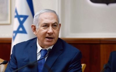Benjamin Netanyahu at the weekly cabinet meeting. Photo: Abir Sultan/AP