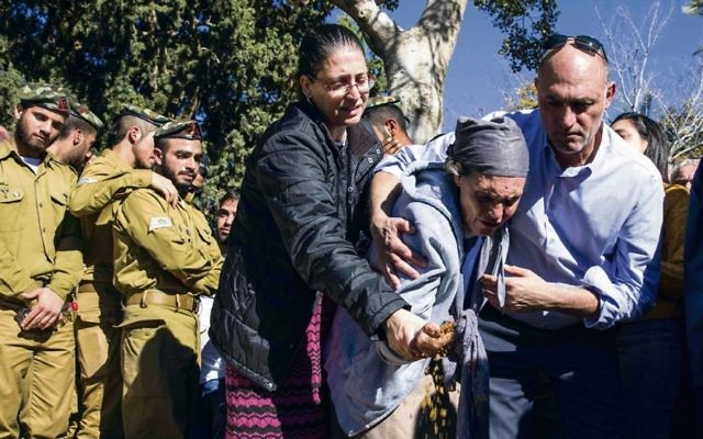 Friends and family at the funeral of Yovel Moryosef. Photo: AP Photo/Tsafrir Abayov