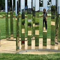 Judi Schiff self-portrait in Jeppe Hein's sculpture at the Point Leo Sculpture Park.