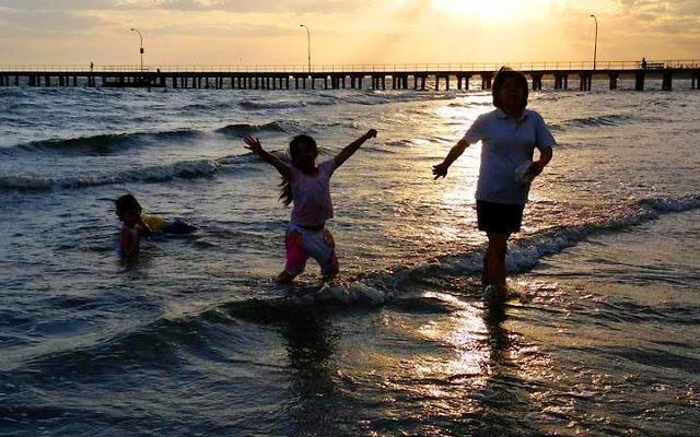 Melly Legiman's children enjoying Dromana beach.