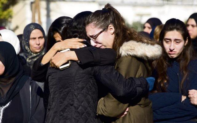 Mourners at the funeral of Aiia Maasarwe in Israel last week. Photo: AP Photo/Ariel Schalit