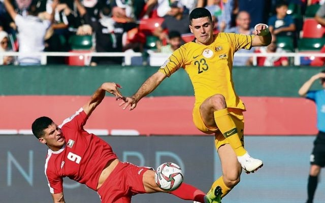 Tom Rogic (right) of Australia in action against Tamer Seyam (left) of Palestine during last Friday's match. Photo: EPA/Mahmoud Khaled